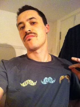 Ali rocking the mo and the tee!